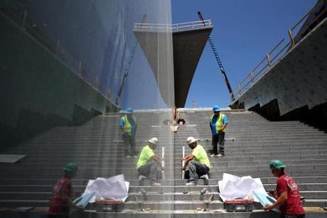 Salvucci Masonry workers worked on steps at Boston Landing.